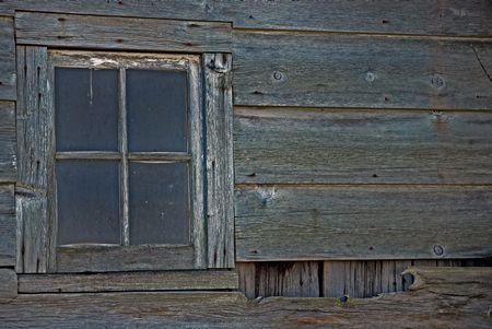 splintered: Old dusty window of a barn.