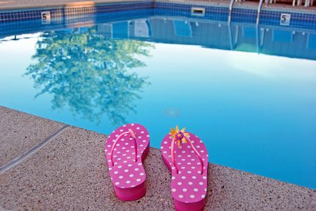 Sandals at poolside.