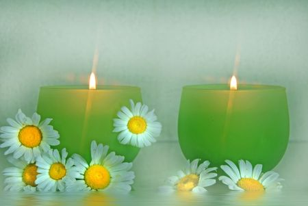 Wild daisies with glowing candles.