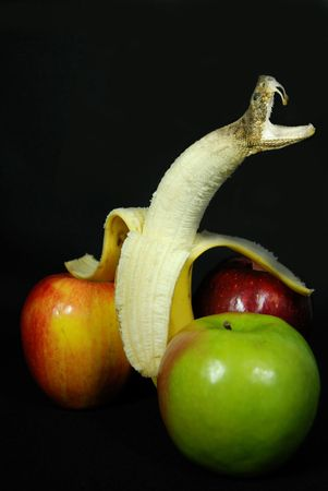 snake head: Snake head erupting out of a banana. Stock Photo