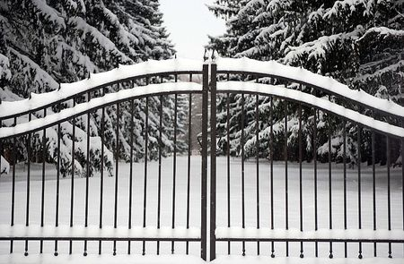 Closed wrought iron gate in the winter.