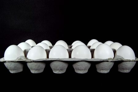 eighteen: Eighteen white eggs in carton. Stock Photo