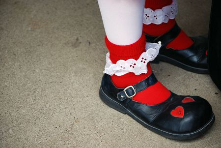 Oversized clown shoes with red socks. photo