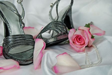 silvery: Silver shoes and pink rose with pearls on white satin.