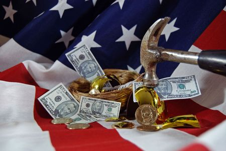 Hammer smashing the gold egg on the American flag. Stock Photo - 3642507