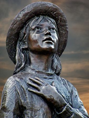 Statue of a young girl pledging allegiance.