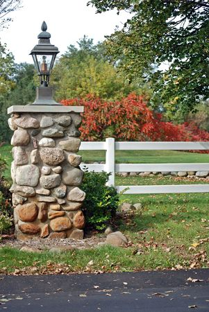 Stone pillar at the entrance of a private drive. Stock Photo - 3705211
