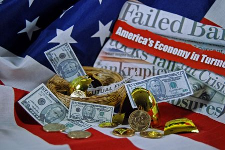 Smashed golden egg and money on a flag. Stock Photo - 3776497