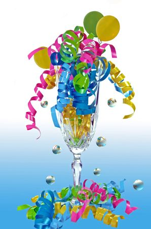 Fun bubbles with curly ribbon and balloons in crystal flute. photo