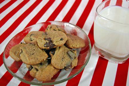 Milk and cookies on stripes. Stok Fotoğraf