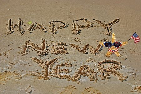 beach happy new year: Starfish with Happy New Year sign on beach. Stock Photo