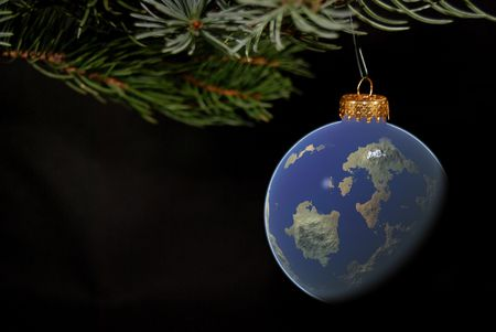 bough: World ornament hanging from a Christmas tree bough. Stock Photo