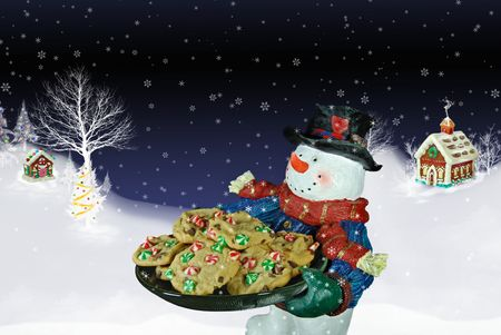 Snowman delivering a plate of cookies in the snow. photo