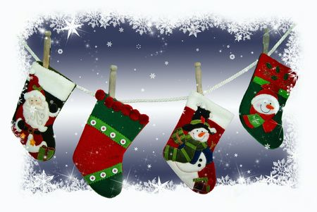 Christmas stockings hanging in the snow. photo
