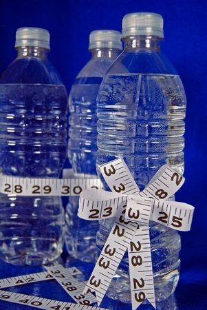 Tape measure bow on bottled water.