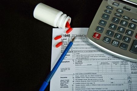 tax form: Income tax form with calculator and aspirins.