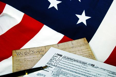 declaration of independence: Tax form and copy of the declaration of Independence on flag.