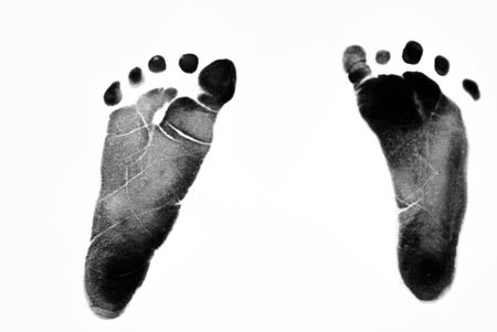 foot marks: Baby foot prints on a white background. Stock Photo