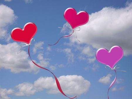Valentine balloons floating in the sky.    photo