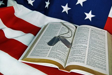 Military dog tags on an open Bible.