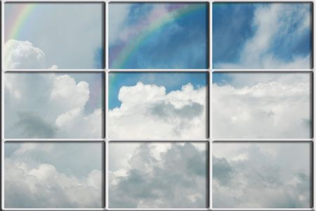 Double rainbow in a summer sky outside the window. Stock Photo