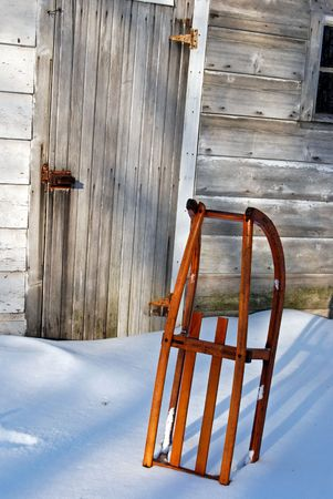 Vintage sled stuck in snow. photo