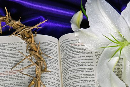 Lily and crown of thorns on Holy Bible. photo