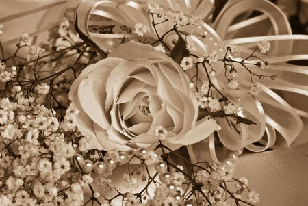 sheen: Pearl and rose bridal bouquet in sepia tones