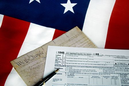 tax form: Tax form and the copy of the U.S. Constitution on a flag.