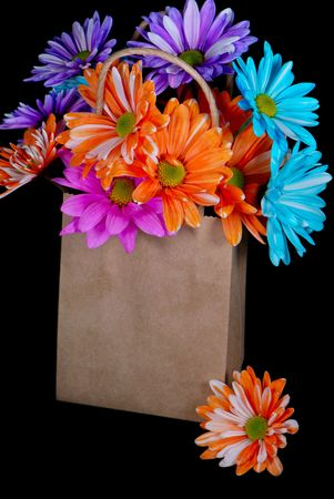 dainty: Bright daisies in a plain brown bag.