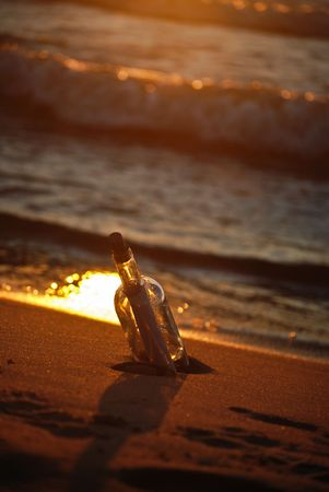 Message in a bottle at sunset time. Stock Photo - 4757053