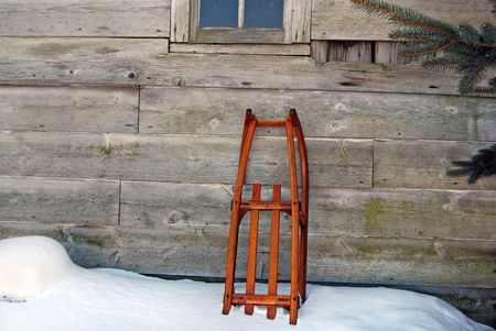 Vintage sled leaning agains an old barn. Stock Photo - 4798618
