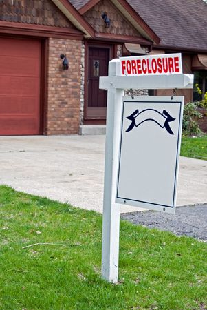 Foreclosure sign in front yard. Stock Photo - 4855201