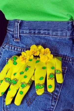 gardening gloves: Fun gardening gloves and pansies in back pocket.