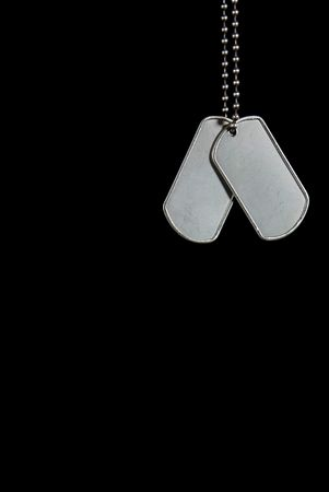 back link: Military dog tags on a black background. Stock Photo