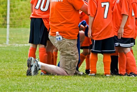 huddle: Soccer coach with his team.