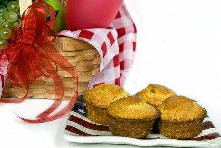 Corn muffins on flag plate with picnic basket. Stock Photo