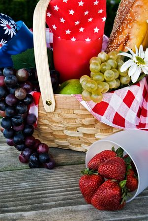 Healthy fruit basket on worn table top. photo