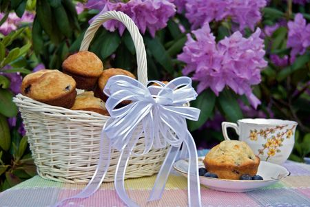 Basket of blueberry muffins for an afternoon tea. Stock Photo