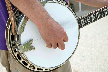 Man playing his banjo. Stock Photo