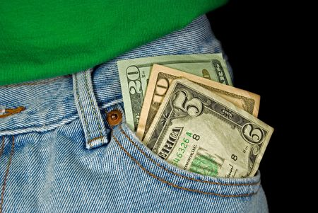 careless: Loose money in front pocket of blue jeans.