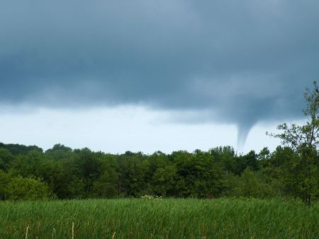 waterspout: A waterspout forming over the marsh. Stock Photo