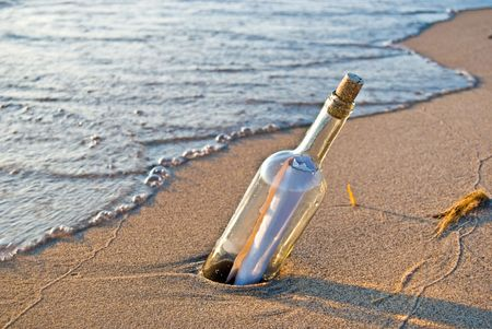 Message in a bottle on the shore.