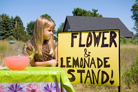 Little girl at her lemonade stand. Stock Photo