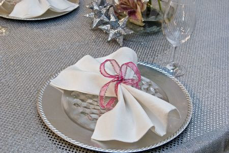 Fancy dinner party table setting in a silver theme. photo