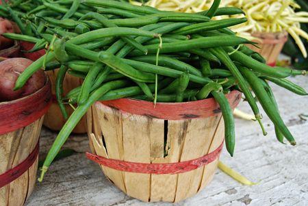 bushel: Overflowing bushel basket of green beans.