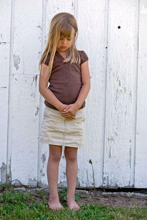 blonde little girl: Little girl standing all alone.