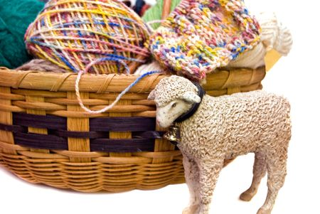 Sheep figurine with a basket of yarn. Stock Photo - 5441113