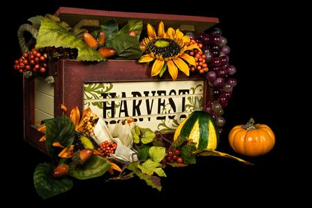 Overflowing harvest box on black. Stok Fotoğraf
