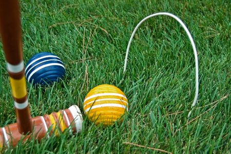 Game of croquet in grass.